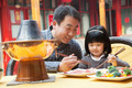 Father and daughter eating Chinese food outside - PhotoDune Item for Sale