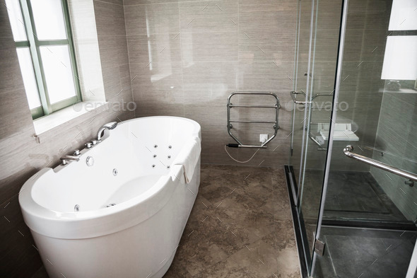 Modern, clean, bathroom with bathtub and shower. - Stock Photo - Images