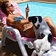 Woman Using iPhone near Pool with a Dog - VideoHive Item for Sale