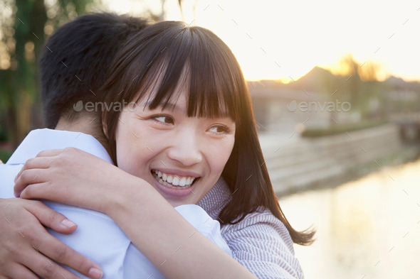 Happy Young Couple Hugging - Stock Photo - Images