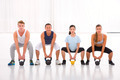 Multiethnic group of people doing kettlebell crossfit exercise - PhotoDune Item for Sale
