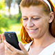 Woman With Smartphone in Park - VideoHive Item for Sale