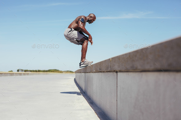 Shirtless young athlete doing jumping workout - Stock Photo - Images