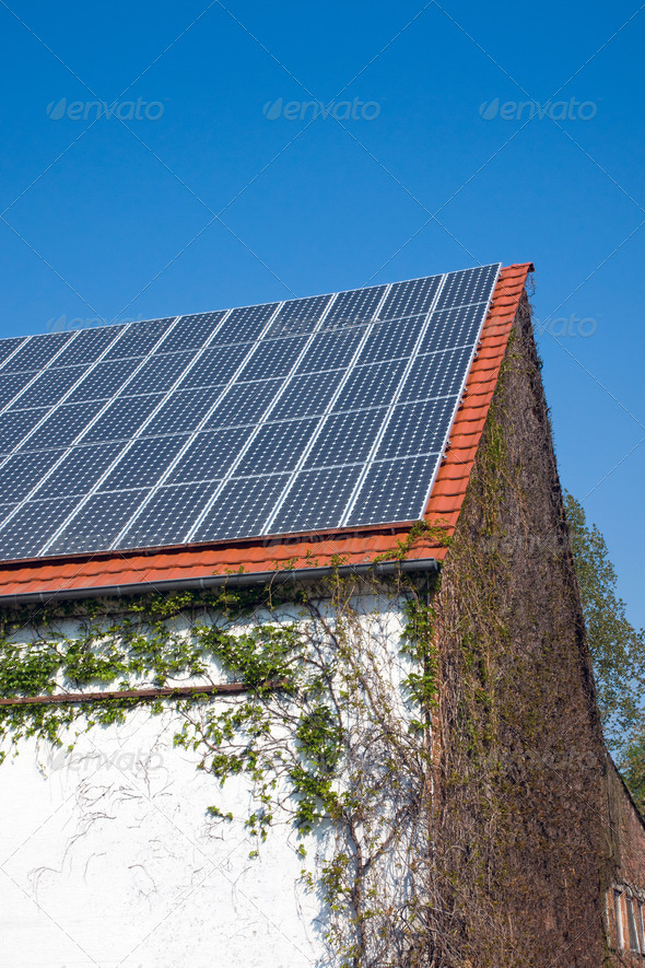Solar cells on an old house - Stock Photo - Images
