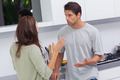 Young couple arguing in the kitchen - PhotoDune Item for Sale