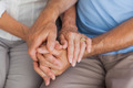 Close up of an elderly couple holding hands - PhotoDune Item for Sale