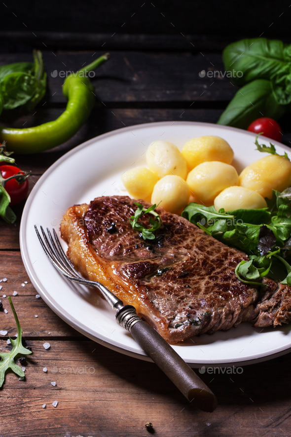 Grilled steak with potatoes - Stock Photo - Images