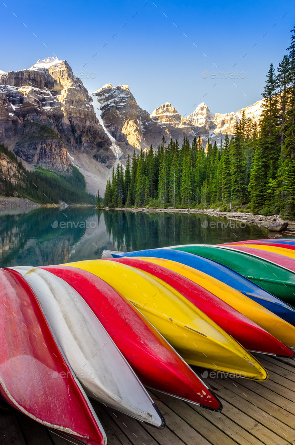Landscape view of Moraine lake with colorful boats, Rocky Mounta - Stock Photo - Images