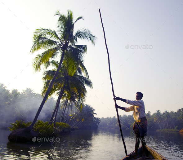 Indian Boatman and Traditional Boat - Stock Photo - Images