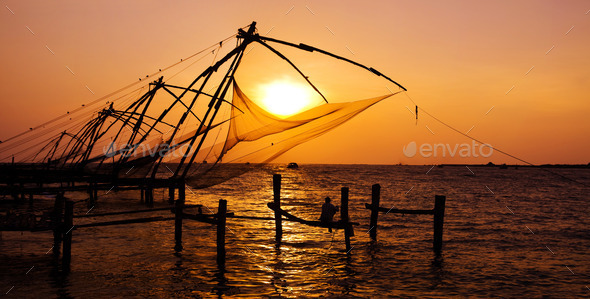 Fishing Nets of Cochin at Sunset - Stock Photo - Images