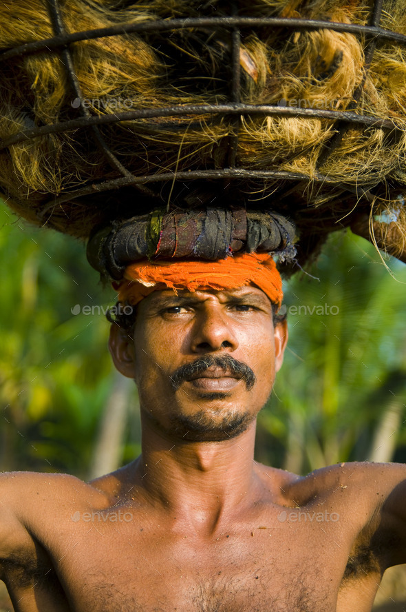 Indigenous Manual Labor Worker Carrying On The Head - Stock Photo - Images