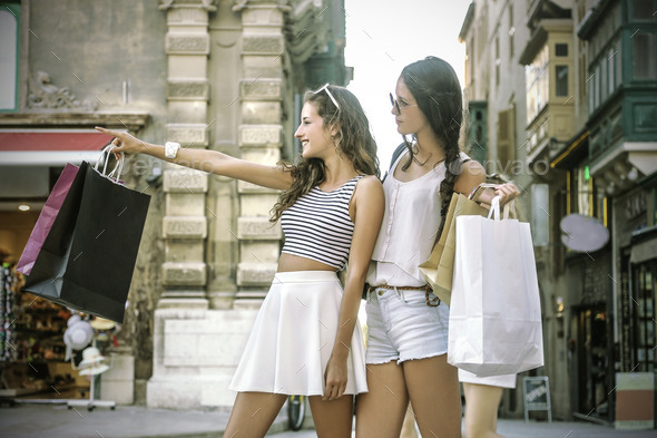 Two girls going shopping - Stock Photo - Images