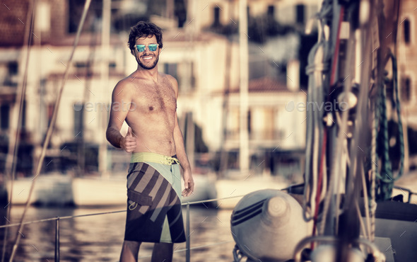 Happy man on the sailboat - Stock Photo - Images