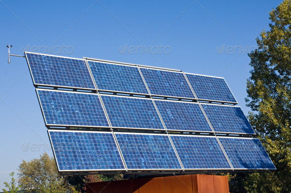 Solar energy panel and trees - Stock Photo - Images