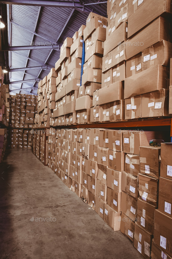 Rows of shelves with boxes in warehouse - Stock Photo - Images