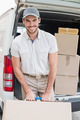 Delivery driver loading his van with boxes outside the warehouse - PhotoDune Item for Sale