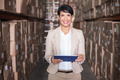 Pretty warehouse manager holding tablet pc in a large warehouse - PhotoDune Item for Sale