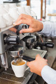 Barista making a cup of coffee at the coffee shop - PhotoDune Item for Sale