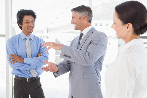 Happy employees having a discussion in the office - Stock Photo - Images