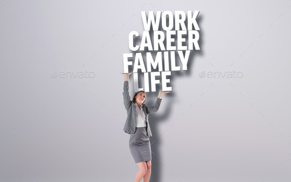 Businesswoman pushing up with hands against grey background with text - Stock Photo - Images