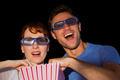 Couple enjoying a movie night in black background