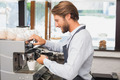 Handsome barista making a cup of coffee at the coffee shop - PhotoDune Item for Sale