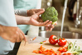Mature couple preparing vegetables together at home in the kitchen - PhotoDune Item for Sale
