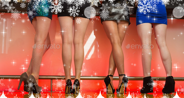 Composite image of a Sexy women legs standing back to camera against snow - Stock Photo - Images