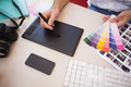 Designer using graphics tablet and colour charts in the office - PhotoDune Item for Sale