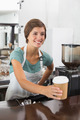 Pretty barista holding disposable cup at the coffee shop - PhotoDune Item for Sale