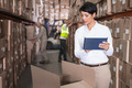Pretty warehouse manager using tablet pc in a large warehouse - PhotoDune Item for Sale