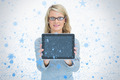 Happy woman presenting her tablet against snow falling - PhotoDune Item for Sale