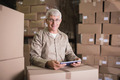 Warehouse worker using digital tablet in warehouse - PhotoDune Item for Sale