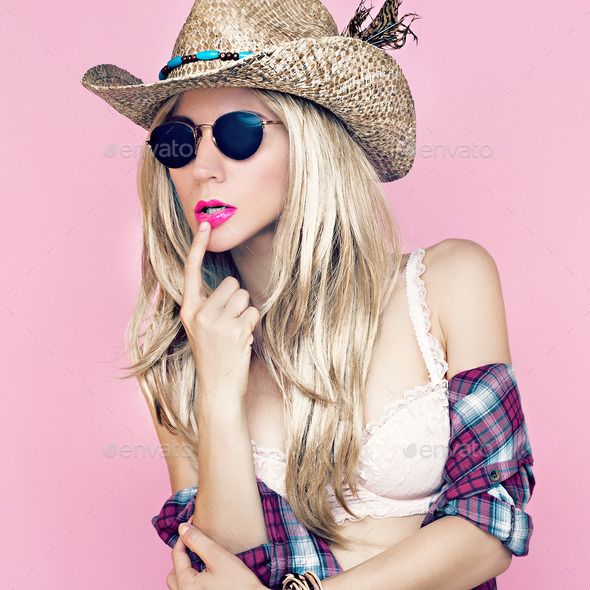 Sexy girl in cowboy fashion style - Stock Photo - Images