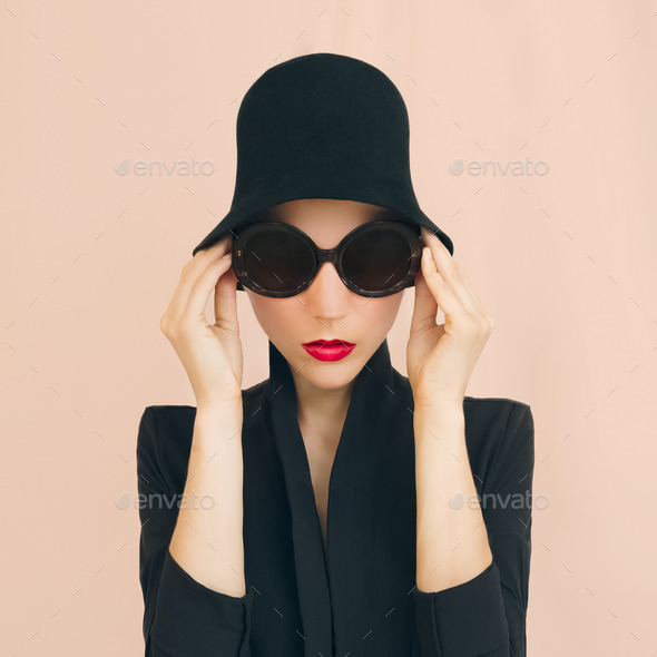 Portrait of elegant lady in a stylish hat - Stock Photo - Images
