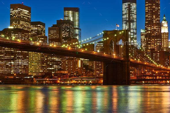 Brooklyn Bridge with lower Manhattan skyline at night - Stock Photo - Images