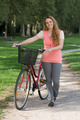 Young woman standing next to her bike - PhotoDune Item for Sale
