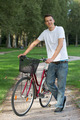 Young man standing next to his bike - PhotoDune Item for Sale