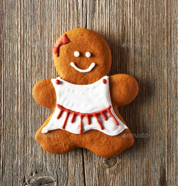 Christmas homemade gingerbread girl cookie - Stock Photo - Images
