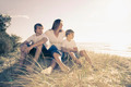 Family sitting on the beach - PhotoDune Item for Sale