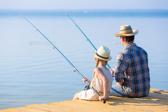 Father and daughter fishing - Stock Photo - Images