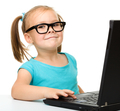 Little girl with laptop - PhotoDune Item for Sale