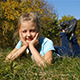 Happy Little Girl Lying On The Grass - VideoHive Item for Sale