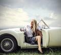 Blonde woman sitting in a car