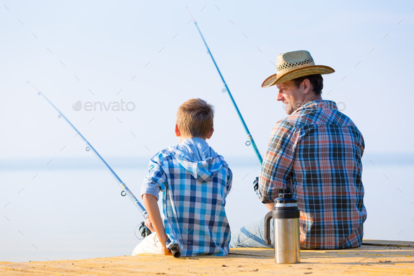 boy and his father fishing togethe - Stock Photo - Images