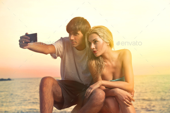 Couple taking a piture - Stock Photo - Images