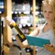 Woman Choosing Wine Using Pad - VideoHive Item for Sale