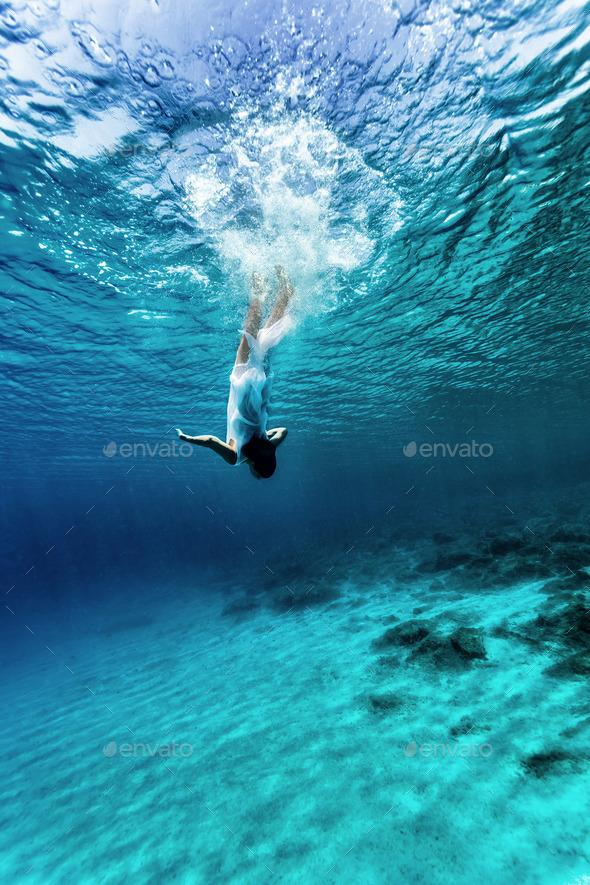 Dancing underwater - Stock Photo - Images