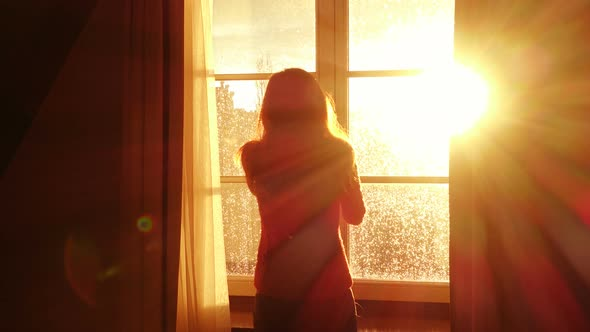 Girl Opening A Window And Looking At The Evening City 3 by azgek ...
