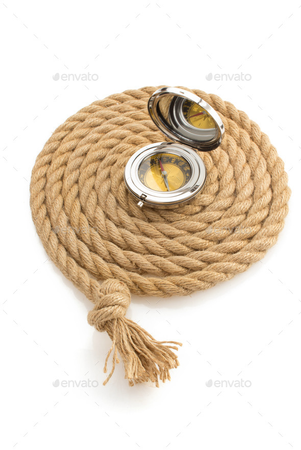 compass and ship rope on white - Stock Photo - Images